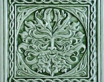 Relief carved Celtic green man ceramic tile