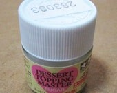 One bottle of Tamiya Dessert Topping Master Fake Sugar. Simulates sugar for your faux sweets.