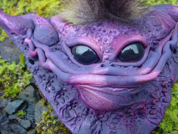 Original purple creature sculpture