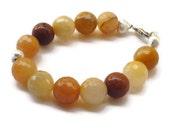 Yellow jade Bracelet with faceted jade beads 7 inches & goldstone beads Orange nectarine