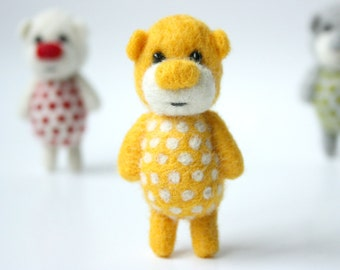 Yellow polka dotted pocket bear