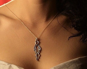 Silver keyhole pendant on a silver chain made in NYC .925 sterling silver