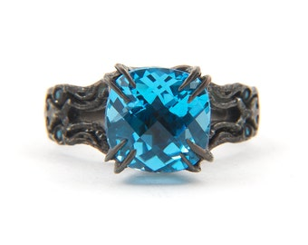 Kathula blue topaz and sapphire ring
