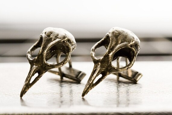 Silver bird skull cuff links