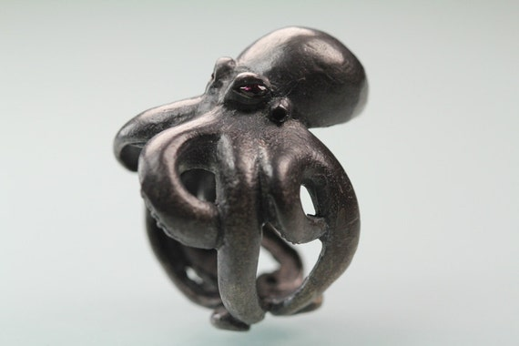 Octopus ring Sterling black silver red ruby eyes  sized  7 to 11  original design carved cast and finished in NYC