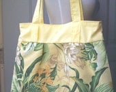 Yellow Floral Purse with Green Leaves.