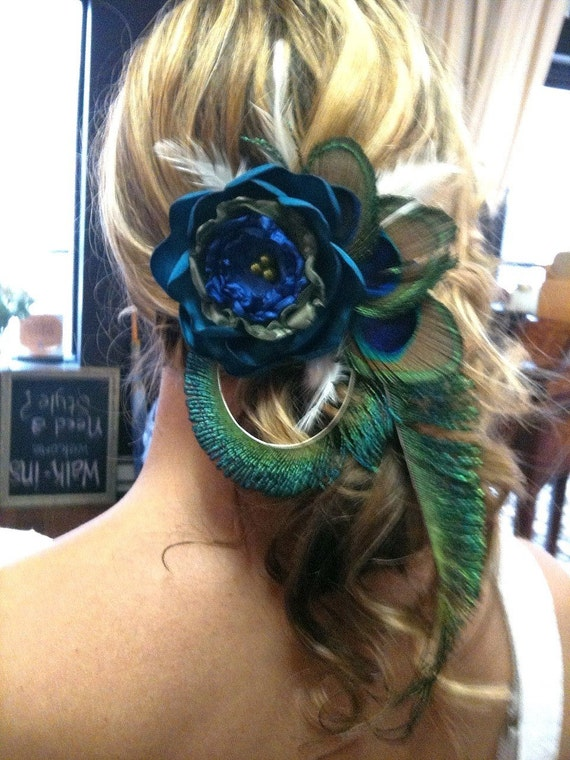 A Beautiful Peacock hair clip with large flower.