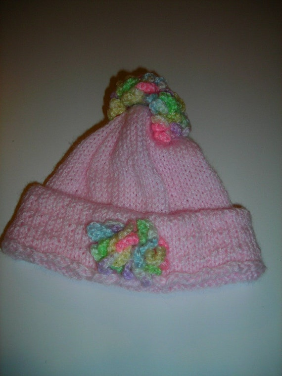 Free Crochet Pattern Multi Colored Hat : Pink Knitted Hat with Crocheted Multi Colored Flowers for