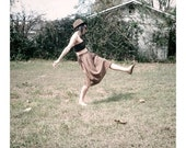 Drum sticks, vintage skirt