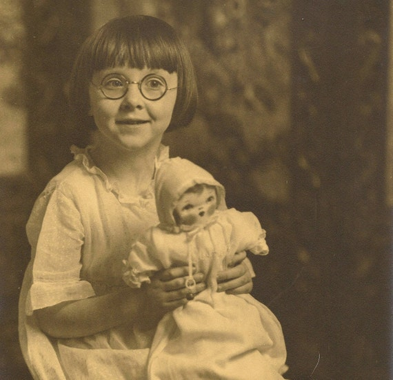 Studio Photo of little girl in glasses holding baby doll - Original vintage 8x10 photograph
