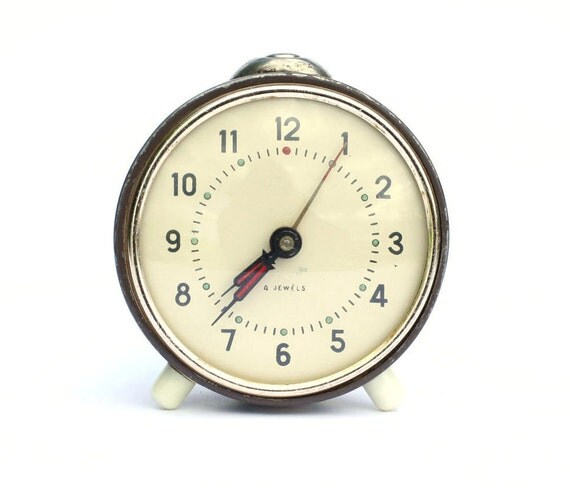 Back to school. Vintage mechanical alarm clock from Russia Soviet Union