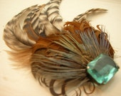 Newbird. feather fascinator with blue vintage stone by fivelives