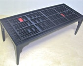 coffee table  made with reclaimed letterpress type trays or printers type drawers