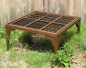 Hand made wood coffee table with a top made from reclaimed letter press type boxes in the Arts and Crafts Style.