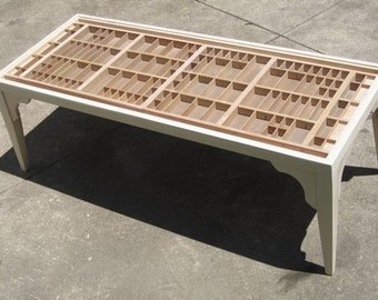 wooden coffee table, with a top made from repurposed wooden letterpress type cases, unfinished, in which you can display collections.