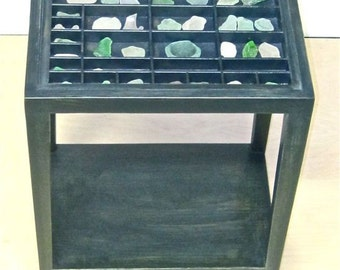 Sea glass end table for displaying your collection of beach glass and other objects such as seashells, jewelry, coins, medals, etcetera.