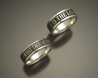 Sterling 'Love is the law love under will' ring size 9.