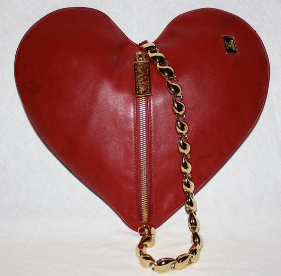 Reserved.....................Authentic VINTAGE MOSCHINO Clutch Soft Leather Heart Gold Chain Handbag