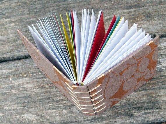 Handbound book sketchbook journal, brown cover colorful pages leaf cutout