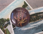 Vintage Paperweight with Dried Flowers and Purple Background