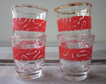 Set of Four Mid Century Modern Shot Glasses with Red Design and Gold Trim