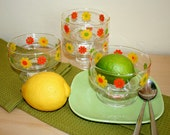 Four footed dessert dishes with cheerful daisies. Retro, mod, orange, yellow green, relief.
