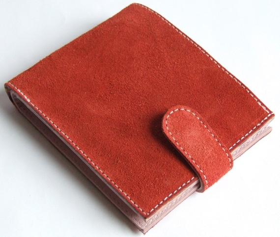 Orange suede billfold wallet with 'bookshelves' print lining