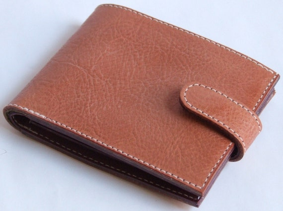 Tan leather wallet with pale green floral lining and oxblood leather inner