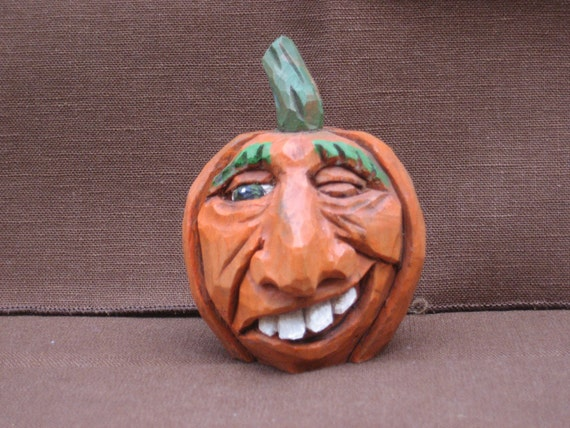 Hand carved halloween pumpkin jack o lantern wood carving