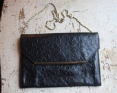 vintage black leather clutch bag