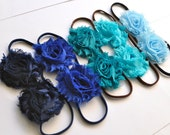 Three stretch blossom headbands for women or girls. Special offer 3 for 18. Over 70 colors and prints available.
