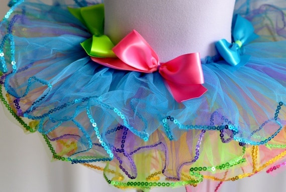Pastel Rainbow Bright Tutu . Bows and edged in sequins. Reversible pink or aqua and ready to ship. Includes Bow Headband.