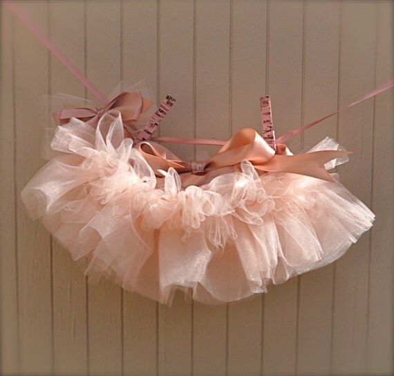 Newborn Tutu--Baby Ballerina Antique Pink . Teeny, tiny and can be hung in the nursery. Clothes pins and ribbon included.