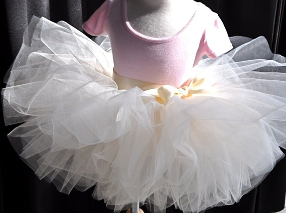Short fluffy girls tutu in many colors. Featured in Martha Stewart's Flower Girl layout.