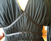 Vintage Black 1970s Goddess wrapped cocktail dress ultimate disco style