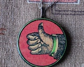 A Ok Handmade Necklace with Round Wood Pendant with Vintage Illustration of Hand and Thumbs Up.