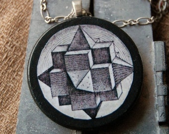 Geek Whatsit Handmade Necklace with Round Wood Pendant with Vintage Illustration of Black and White 3 Dimensional Shape.