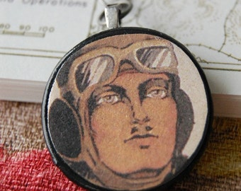 Come Fly with Me Necklace with Circle Pendant of Vintage Illustration of 1920s Pilot on Brushed Silver Long Link Chain.