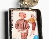 1.5 Inch X 1 Inch Soldered Vintage Sewing Pattern and Pink and Orange Fabric Charm Pendant with 30 Inch Ball Chain