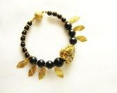 Black and Gold Heart Bracelet - heart and leaves beaded bracelet
