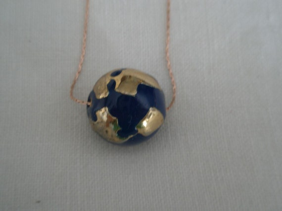 Got the World on a String Blue Enamel and Gold Tone Pendant Necklace