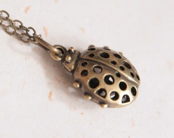 Little Ladybug Necklace (N215) in antique brass color