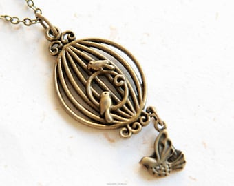 Inside & Outside - Bird and cage necklace (N257)