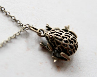 Little froggie Necklace (N271) in antique brass color