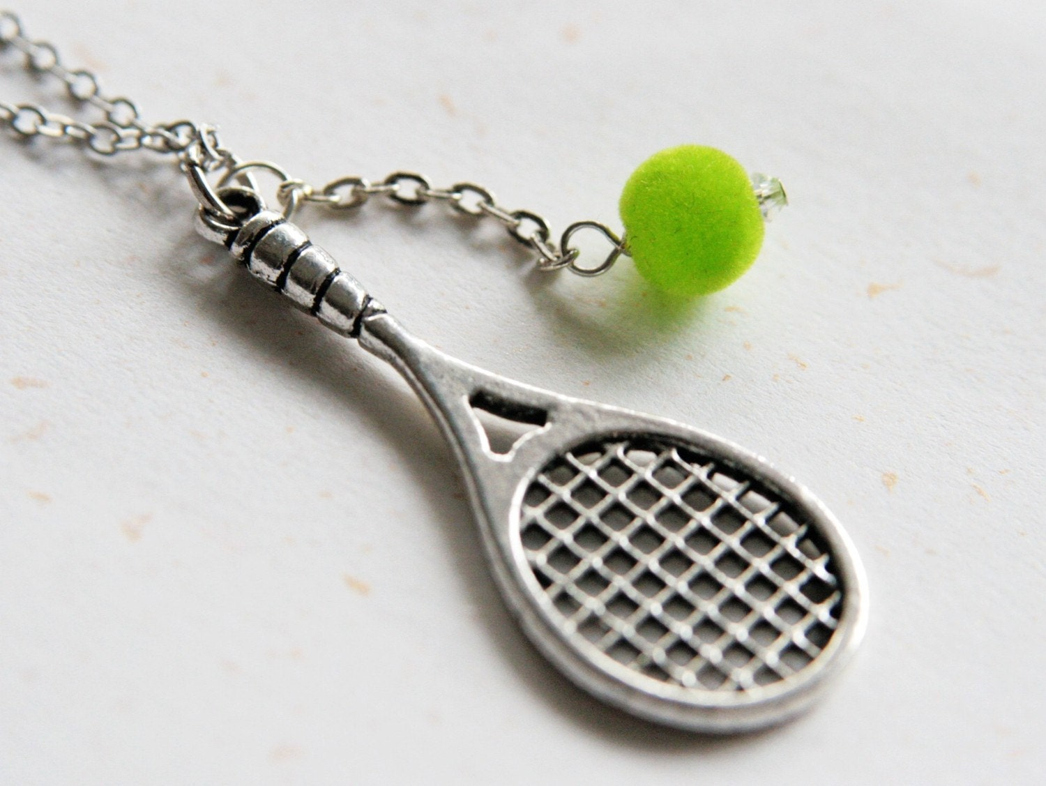 tennis racket and necklace n229 exercise more