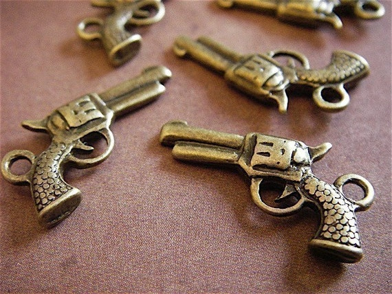 10 - Antique Bronze- Pistol Charm (ABPC)