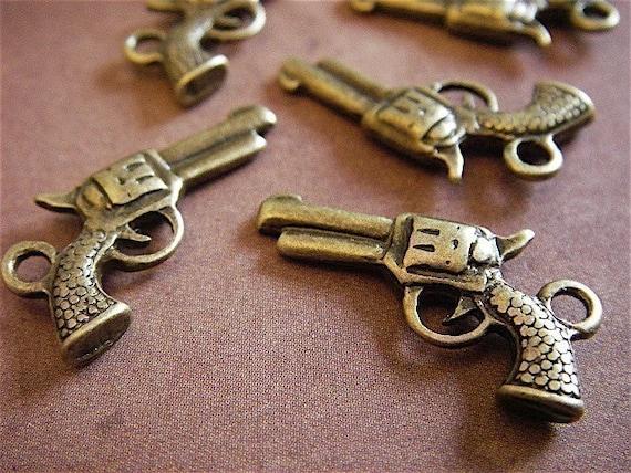 10 - Antique Bronze- Pistol Charm (ABPC)