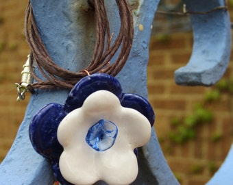 Dark blue, white, periwinkle triple-flowered necklace