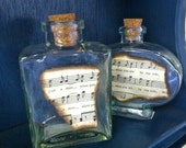 Set of 2 Vintage glass jars with sheet music
