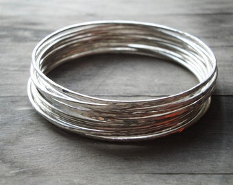 hammered sterling silver bangle bracelets: set of 10